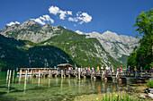 People leaving boat and walking on landing stage, Salet, lake Koenigssee, Berchtesgaden range, National Park Berchtesgaden, Berchtesgaden, Upper Bavaria, Bavaria, Germany
