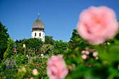 Abbey garden and Frauenwoerth church, Frauenchiemsee island, lake Chiemsee, Chiemgau, Upper Bavaria, Bavaria, Germany