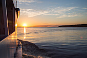River cruise ship MS General Lavrinenkov (Orthodox Cruise Company) at sunset, Svir river, Lake Onega, Russia, Europe