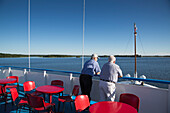Two men on the deck of river cruise ship MS General Lavrinenkov (Orthodox Cruise Company), Svir river, Lake Onega, Russia, Europe