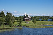 Lake shore and wooden church at Kizhi Pogost, Kizhi Island, Lake Onega, Russia, Europe