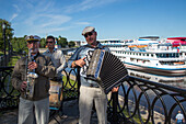 Musicians greeting passengers from the river cruise ships on the pier, Uglich, Russia, Europe
