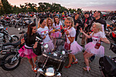 Young women on a hen night, Bachelorette party amidst motorcycles at Sparrow Hills, Moscow, Russia, Europe