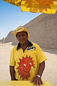 Cheerful ice cream cart salesman outside the archeological ruins at Chan Chan, the former capital of the Chimu Empire (UNESCO World Heritage Site), Trujillo, La Libertad, Peru