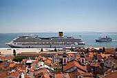 Cruise ship Costa Pacifica (Costa Crociere) docked at the Terminal de Cruzeiros de Santa Apolonia near Alfama district with cruise ship MS Delphin (Passat Kreuzfahrten) approaching, Lisbon, Lisboa, Portugal