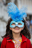 Young girl with Venetian carnival mask on Piazza San Marco, Venice, Veneto, Italy, Europe