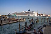 Gondolas and cruise ship Norwegian Jade (Norwegian Cruise Line) in Bacino di San Marco with Isola di San Maggiore island in distance, Venice, Veneto, Italy, Europe