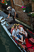 Happy couple in a gondola, Venice, Veneto, Italy, Europe