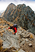 mountaineer on the way to Vf. Moldoveanu, Fagaras Mountains, Transylvania, Romania