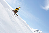 Skier jumping over a cornice, Davos, Grisons, Switzerland