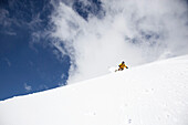 Man downhill skiing in deep snow, Davos, Grisons, Switzerland