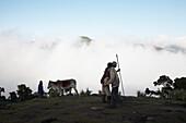 Two herdsmen welcoming, Bale Mountains National Park, Oromia Region, Ethiopia