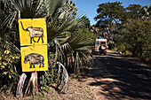 Animal signs beside a road, Livingstone, Southern Province, Zambia