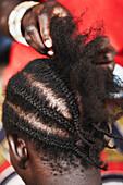 Cornrowing hair, Magadala, Mali