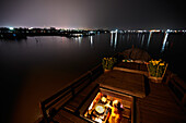 Woman cooking in a galley on a house boat, Long Xuyen, An Giang Province, Vietnam