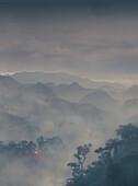 Ethnic hut and fog on a mountain, Banaue, Ifugao, Philippines, Asia