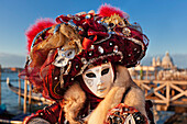 Portrait of a woman wearing traditional costume and mask, Carnival of Venice, Veneto, Italy