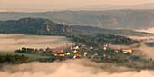 View over Weissig in morning mist with Rauenstein in background, Struppen, Saxon Switzerland, Saxony, Germany
