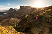 Young woman running on a trail, Quiraing, Trotternish peninsula, Isle of Skye, Scotland, United Kingdom
