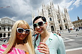 Two young women at Piazza del Duomo with Milan Cathedral, Milan, Lombardy, Italy