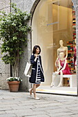 Woman window shopping, Via dell Spiga, Golden Triangle, Milan, Lombardy, Italy