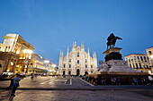 Piazza del Duomo with equestrian statue, Milan Cathedral and Galleria Vittorio Emanuele II in the evening, Milan, Lombardy, Italy