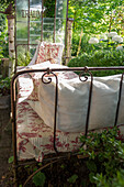 Garden still life with antique bed and summer flowers, Freiamt, Emmendingen, Baden-Wuerttemberg, Germany