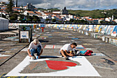 Sailors painting murals, jetty covered with murals by yacht crews during their stopover of the Atlantic Ocean, Horta, Faial Island, Azores, Portugal