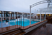 Swimming pool aboard the cruise ship MS Deutschland (Reederei Peter Deilmann) during stormy seas, Drake Passage, near Falkland Islands