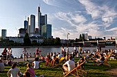People relaxing on the banks of the Main, Frankfurt am Main, Hessen, Germany