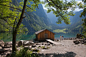 Two women at the boat house at Obersee, Koenigssee, Berchtesgaden region, Berchtesgaden National Park, Upper Bavaria, Germany