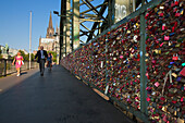 Love locks on Hohenzollern bridge, view to Cologne cathedral, Cologne, Rhine river, North Rhine-Westphalia, Germany