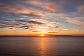 Sunrise at sea, Jasmund National Park, Ruegen island, Baltic Sea, Mecklenburg Western-Pomerania, Germany