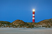 Lighthouse in the dunes along the beach, Kniepsand, Amrum island, North Sea, North Friesland, Schleswig-Holstein, Germany