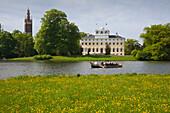 Boat trip on the lake in front of Woerlitz castle, Woerlitz, UNESCO world heritage Garden Kingdom of Dessau-Woerlitz, Saxony-Anhalt, Germany