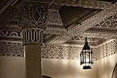 Moroccan Lamp casting light and shadows, Villa des Orangers, Marrakech, Morocco