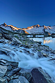 Mountain river flowing into lake Schwarzsee, Dritte Hornspitze and Turnerkamp in background, Zillertal Alps, valley Zillertal, Tyrol, Austria