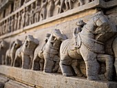 Statues of horseback riding warriors on exterior wall of a temple in Udaipur, Rajasthan, India