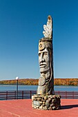 Wood craving of Indian totem pole at lakeside in Wakefield, Michigan, USA