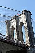 Looking up at the Brooklyn side tower of the Brooklyn Bridge, Brooklyn, NY, USA