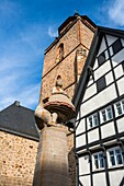 Statue of Goose Lizzy Gänseliesel with the Walpurgiskirche in the background in Alsfeld on the German Fairy Tale Route, Hesse, Germany, Europe
