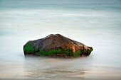 Rock with moving ocean water