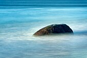 Rock with moving ocean water, Martha´s Vineyard, USA