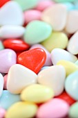 a bowl of heart shaped sweets, heart candy