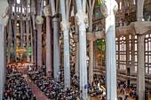 Mass,Interior of Basilica Sagrada Familia,nave, Barcelona, Catalonia, Spain