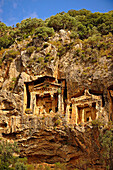The Hellenistic temple fronted Tombs of Kaunos, 4th - 2nd cent  B C, just outside the archaeological site of Kounos on the oposite side of the Calbys river from Dalyan, Turkey  Kaunos is on the border of Lycia & Caria and the Kaunos rock tombs differ sli