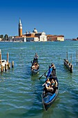 Gondolas at St Mark´s Square with the island of San Giorgio Maggiore behind, with its church front designed by Andrea Palladio and begun in 1566  Venice Italy