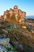 Ruined chapel of St. Michael dating from 1409 on the top a 60ft high Roche Rock, Cornwall, England.