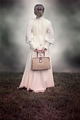 a woman in a victorian dress with a handbag made of bast