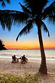 Tourists resting, Thailand Beach after sunset, Koh Samet Island, Thailand